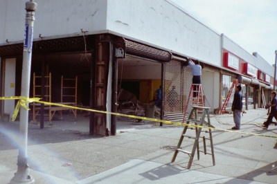 Strip mall new roll down grille gates with steel framing of openings, chain operated type (Queens NY) During photo