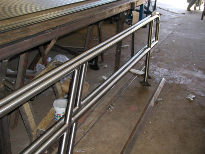 Polished stainless steel pipe railing w/ base plate. (Queens, NY)