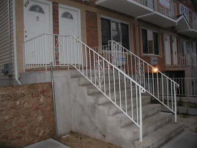"Steel welded economy stair railings with ½"" solid pickets and handrail molding on  top. (Bronx, NY)"