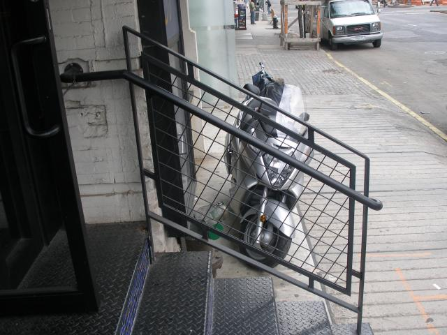 Steel welded wire mesh guard rail with hand rail. (Manhattan, NY)