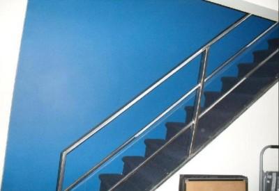 Polished tube steel railings mounted to stringer. (Lower Manhattan)