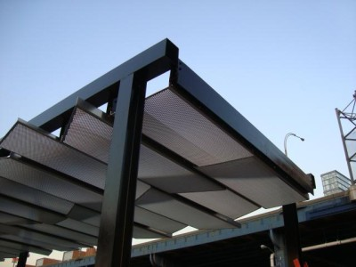 Welded tubular steel canopy with aluminum in fill panels. (Municipality - Bronx, NY)