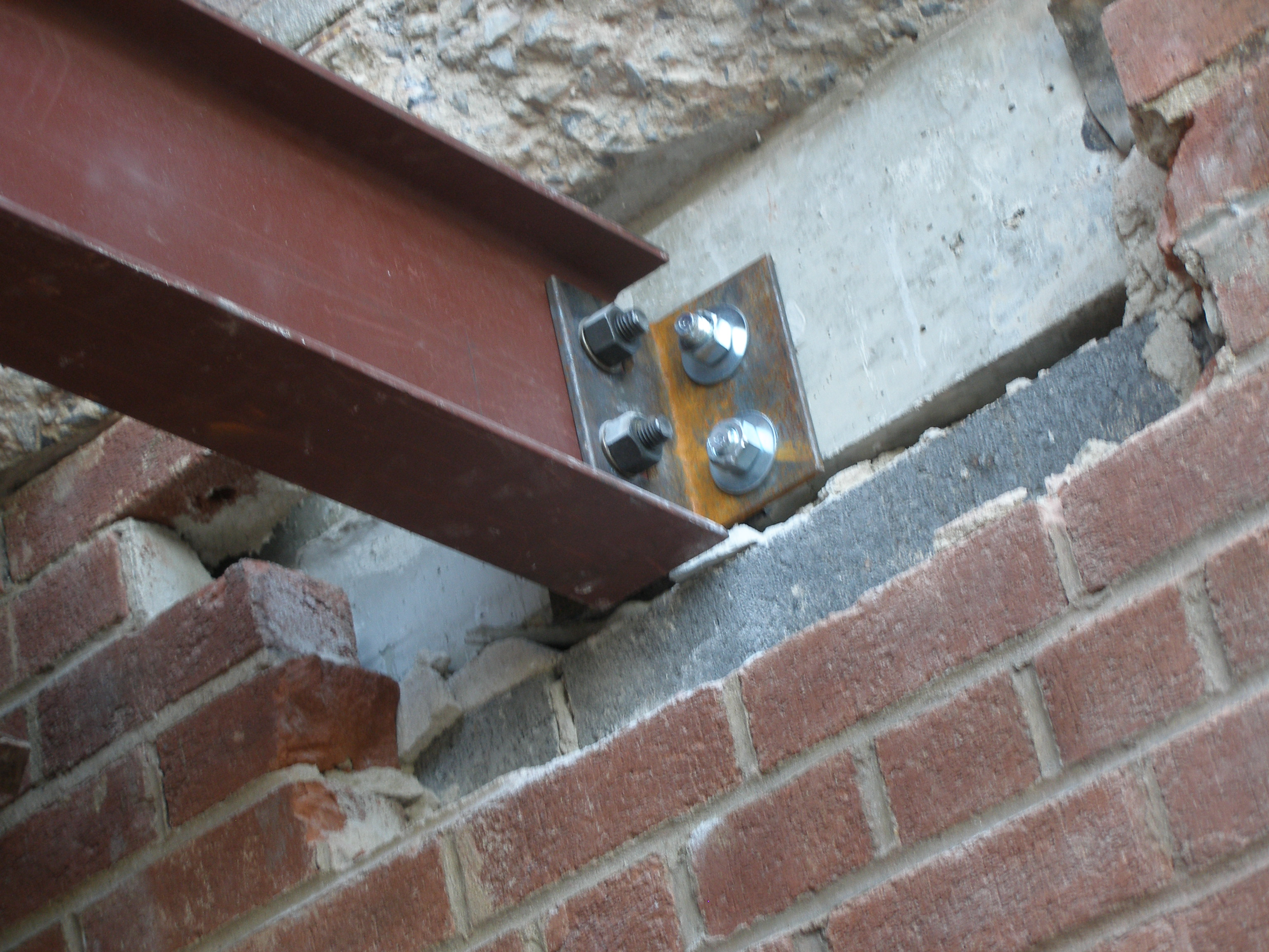 Structural steel threaded rod epoxied mechanical attachment to masonry structure. (Queens, NY)