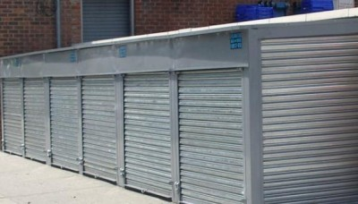 Solid Galvanized Steel Pushup Roll down Security Gate reverse mounted with back plates. (Bronx, NY)