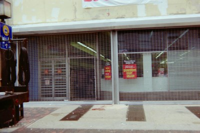 (2) two units 30' long straight link mall type see through grille electric roll down gates. (Philadelphia, PA)