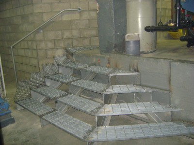 Custom 3 sided galvanized steel grating staircase fully welded with pipe rails. (NY, NY)