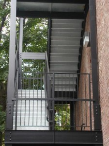 Galvanized diamond plate steel staircase with landings, railings, and handrails. Painted structure. (Bronx, NY)