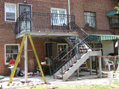 Galvanized open tread staircase and deck/ porch with custom painted, bellied railings. (Queens NY)