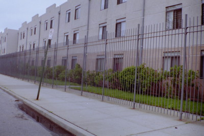 "10' tall solid ¾"" bar plain welded fence mounted on 2"" solid steel posts in 36"" concrete footings. (Brooklyn, NY)"