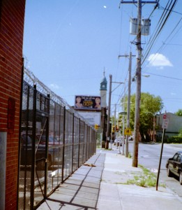Expanded metal mesh welded steel fence with motorized roll down coiling gate with barded wire and razor ribbon for parking lot. (Brooklyn, NY)  2 of 2