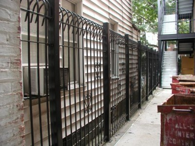 "Solid steel bar 8' defender fence.  Mounted on 3""x ¼"" tube steel posts with caps.(Brooklyn, NY) 2 of 2"