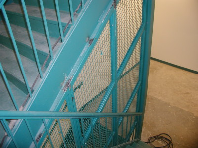 Welded wire mesh steel staircase dividers. (Bronx, NY)