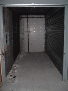 Expanded metal steel mesh welded cage security room with solid roll down gate door. (Brooklyn, NY)