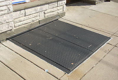 Diamond plate solid steel cellar/hatch double doors have welded angle frames with concealed hinges all built as one unit and are custom made to fit any sidewalk opening. Expanded metal interior sidewalk door can be made inside of frame opening to allow ventilation and maintain security. (New Jersey)