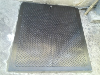 Sidewalk steel cellar door. Commercial diamond plate. (Queens NY)