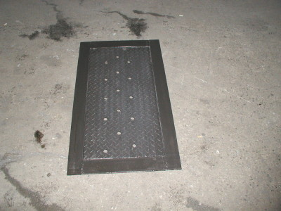 Diamond plate steel ventilated fixed sidewalk door with frame. (Brooklyn, NY)