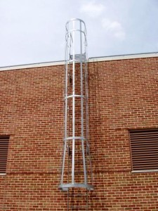 25 foot exterior roof ladder with steel cage. Galvanized with platform over parapet. (Queens, NY)