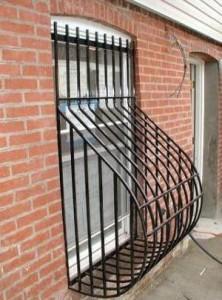 """Steel ½"""" bar bellied window guards. (NY, NY)"""