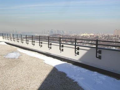 Parapet welded pipe railing. Powder coated and plate / bolted – Multi unit residential (Queens NY)