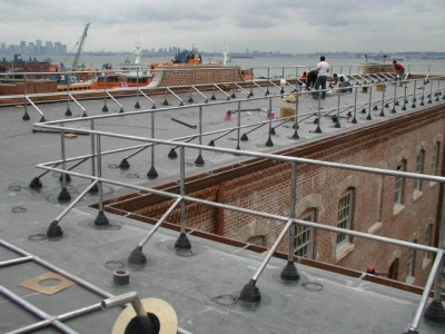 Welded stainless steel parapet guardrails/ roof rails with rubber roof booties. (Brooklyn and Staten Island NY)