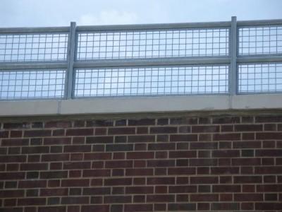 Steel mesh parapet guard railing educational / medical facilities. (Queens, NY)