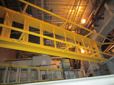 Boiler room catwalks and fixed ship ladders constructed of structural steel channel, galvanized grating all shop welded prepped for fully bolted assembly onsite. Painted safety yellow,welded pipe railings are attached by bolting to stringer channel.