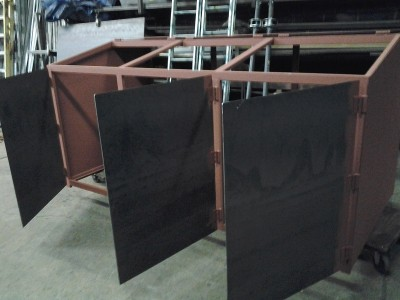 Garbage bin during the fabrication process showing steel beam inside.