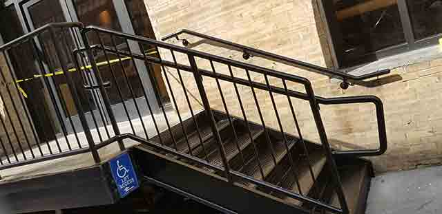 metal steps with picket guardrails and piperail
