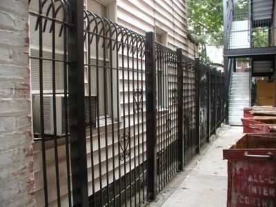 "Solid steel bar 8′ defender fence. Mounted on 3″x ¼"" tube steel posts with caps.(Brooklyn, NY) 2 of 2"