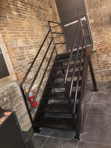 Diamond Plate Iron Stairs with Piperails