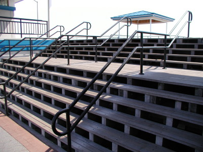Custom steel 2 line pipe railings flush mounted ADA compliant