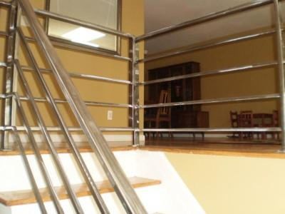 Interior flush mounted steel stair rails
