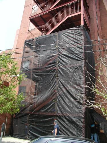 Structural commercial steel pan stair tower structural framing, guardrail stairs landing protective debris mesh