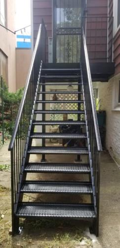 exterior metal stairs open tread diamond plate fully welded steel steps solid railings.