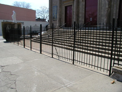 "Simple 6′ welded steel bar fence with scalloped top and 2"" tube steel parts and welded caps. (Queens, NY)"