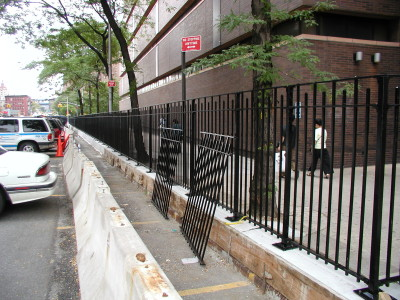 Solid steel 4′ fence, curb mounted/ welded base plates. (NY, NY)