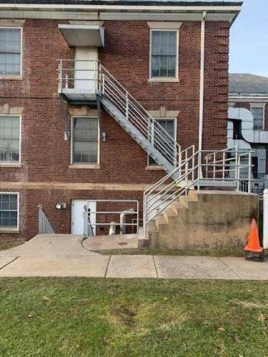 metal fire egress staircase pipe railings