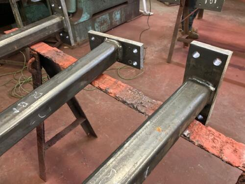 Tube steel columns welded floor plates prepped expansion bolts